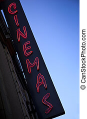 Neon sign of a movie theater in town