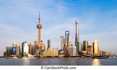 Shanghai bund skyline in a clear day with blue sky.