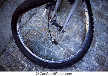 Wheel - A broken wheel bike on a paved square