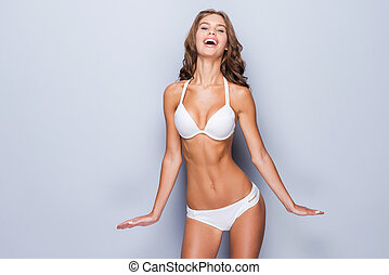 Proud of her perfect body. Attractive young brown hair woman...
