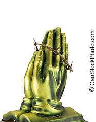 Bronze statue praying hands with the crown of thorns isolated on