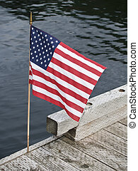 American Flag. - American flag, stars and stripes,on dock.