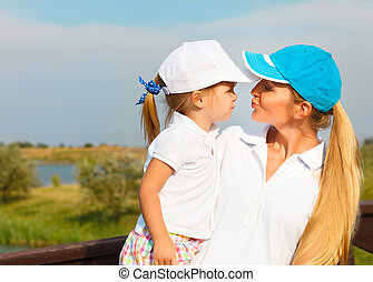 Mother and her little daughter at the golf course