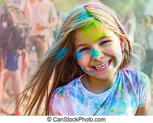 Portrait of happy litttle girl on holi color festival -...