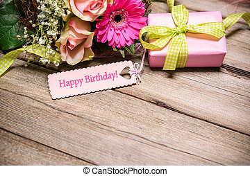 Happy Birthday - Bunch of flowers and tag with text on...