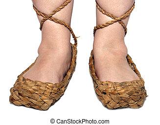 woman legs in russian bast shoes