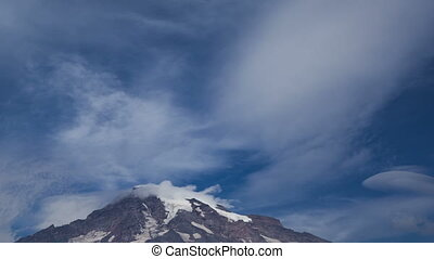 Time lapse zoom out Mt Rainier wit - Time lapse zoom out of...