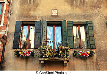 Traditional windows of typical old Venice building ,Italy.