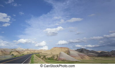 Time lapse pan and tilt shot Badlands Loop Road through the...