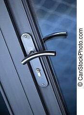 Handle - Close up of an aluminum door handle