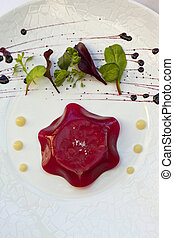 Gastronomic dish - Foie gras and beetroot jelly, green salad...