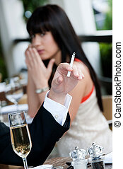 Woman Covering Nose - A young and attractive woman covers...