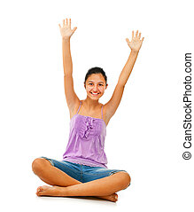 Sitting teenage girl while rejoices with arms up - Sitting...