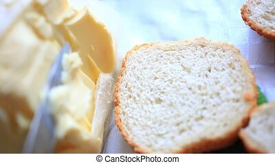 Butter smears on Slices of Wheat Bread , closeup. HD....