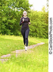 Caucasian Sportwoman Having Her Regular Training Outdoors....