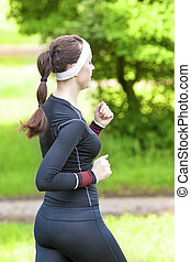 Sport Training Concept: Back View of Caucasian Brunette...