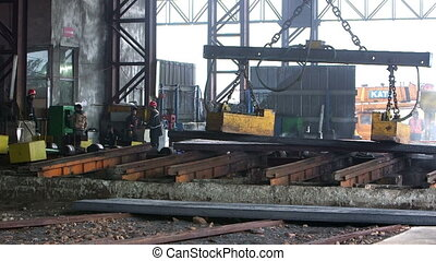 Workers transfer steel blocks - Workers transfer finished...