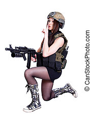 Woman in a military camouflage sitting with the assault rifle