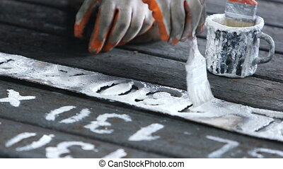 Workers writing id numbers on steel - Workers writing id...