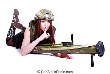 Woman in a military camouflage with a grenade launcher...