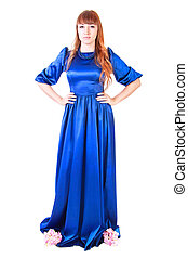 Beautiful young woman in a long blue evening dress isolated...