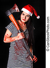 Happy young woman in a Christmas hat with a big bloody axe