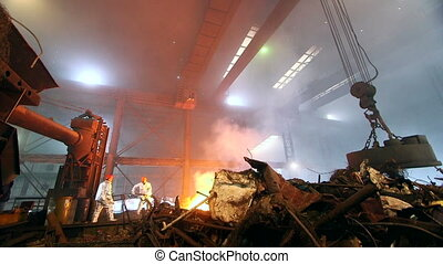 Workers controlling smelting iron - Hard work in the...