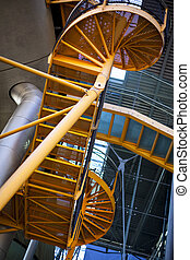 Staircases - Yellow staircases and roof in a modern building