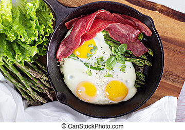 Baked eggs with asparagus and bacon - Baked eggs with...