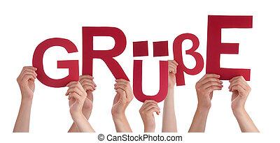 People Holding German Word Gruesse Means Regards