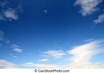 deep blue sky with clouds background