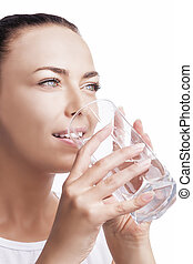 Portrait of Caucasian Female Drinking Water and Smiling -...