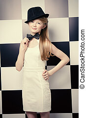 chessboard style - Elegant teen girl wearing white dress,...