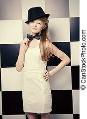 chessboard style - Elegant teen girl wearing white dress,...