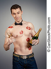 casanova - Elegant sexy man shirtless holding a bottle of...