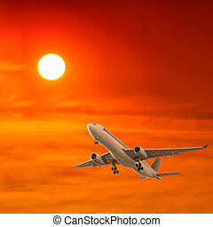 commercial airplane flying with sunset background