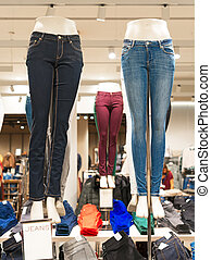 Jeans on mannequin in clothing store.