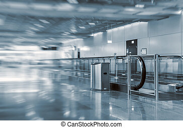 Airport interior with escalator. Motion blur.