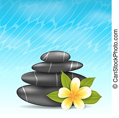 Natural background with frangipani flower (plumeria) and pyramid zen spa stones