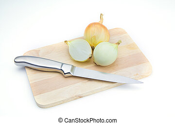 Onion on chopping board