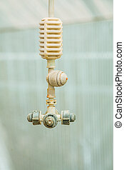 agricultural equipment water sprayer in greenhouse close up...