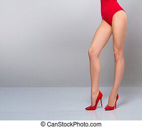Sexy legs over grey background