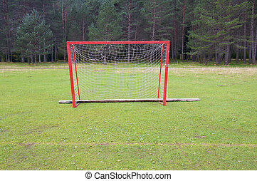 goal - red goal in a meadow with forest in Pyrenees