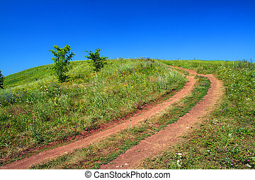 road uphill - rural road uphill on green field