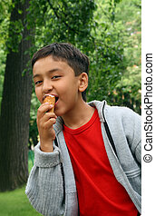 boy eating ice-cream - asian boy eating ice-cream