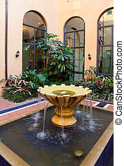Courtyard Fountain - Plant and fountain in a new-style...