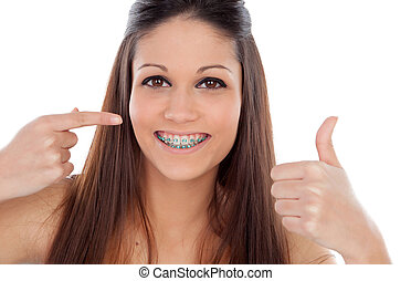 Attractive young woman with brackets saying Ok