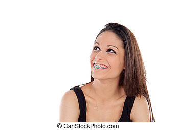 Smiling cool girl with brackets looking up