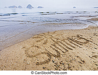 word summer written in the sand on the beach