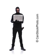 Thief in black mask - Thief in action stealing information...